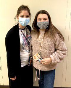 Student Abigail Schmitt with her teacher Emily Canfield