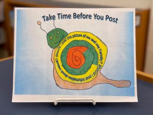 """Joseph Alkhoury's winning poster contest entry, """"Take time before you post"""""""