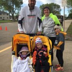 A family participates in the Kennedy Fun Run