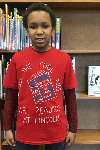 Student wearing Lincoln reading t-shirt