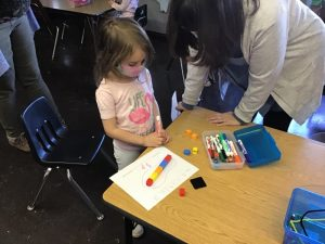 Preschooler measuring foot