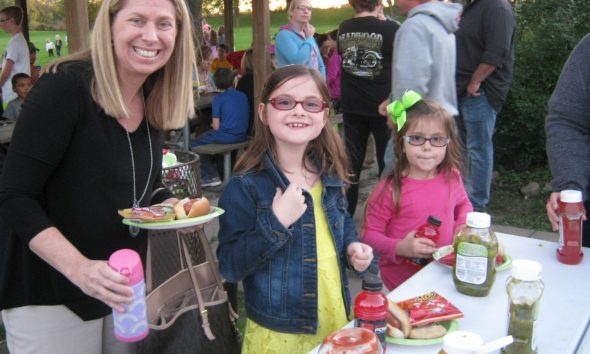 News families gather for the school picnic