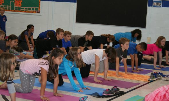 News students practice yoga