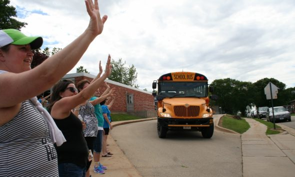News teachers and staff wave good bye to students