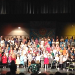 Kindergarten and 1st grade students perform their music program