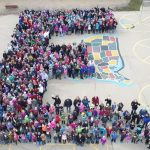 Students and staff form a giant E on the Eisenhower playground.