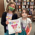 Students with new library books